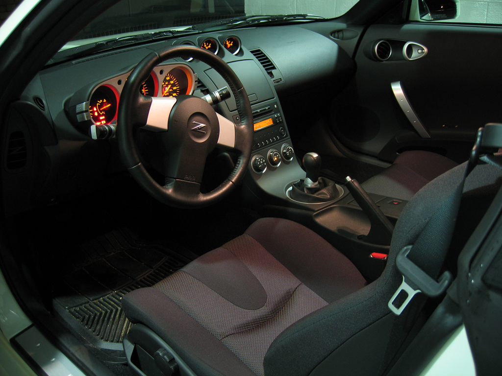Review 2004 nissan 350z driveandreview the interior of the 350z is tight but very comfortable 2004 nissan 350z gauges vanachro Image collections