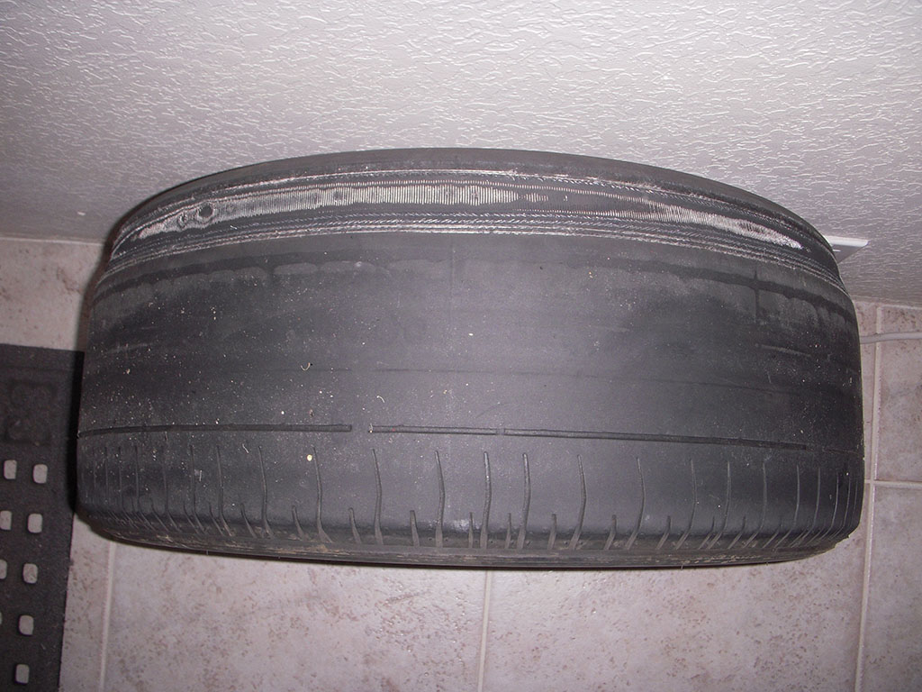 steel belts showing through on bald tire