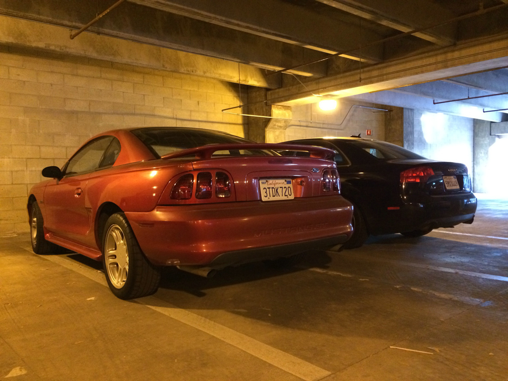 mustang parked in a parking garage