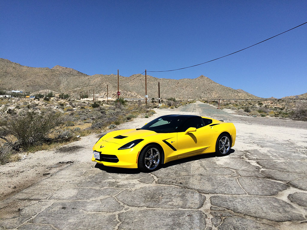 taking pictures of the corvette in the desert