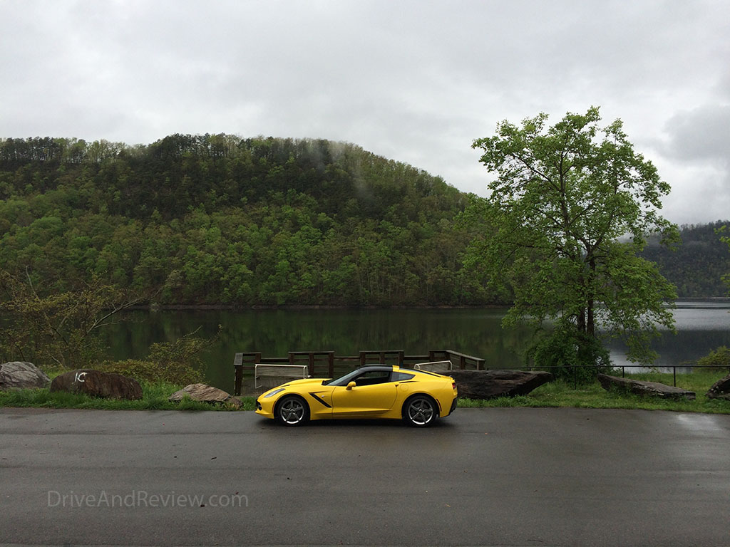 corvette posing against the Little Tennessee River bank