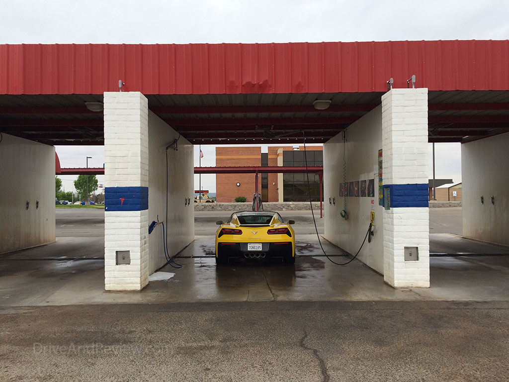 corvette c7 in a coin operated car wash