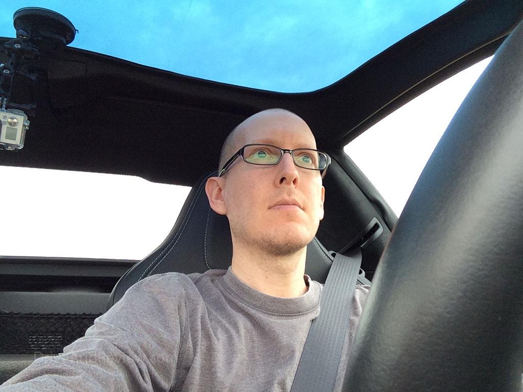 selfie taken while driving a c7 corvette