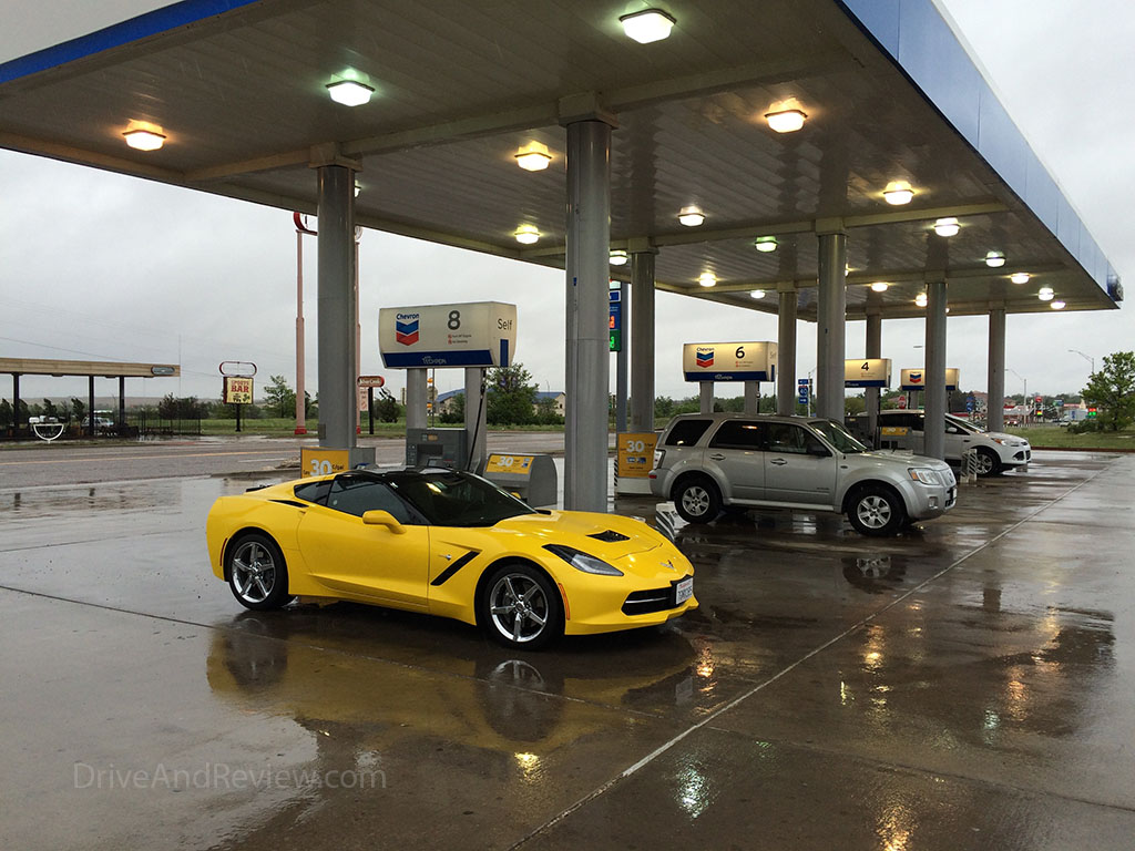 yellow c7 corvette at the gas station