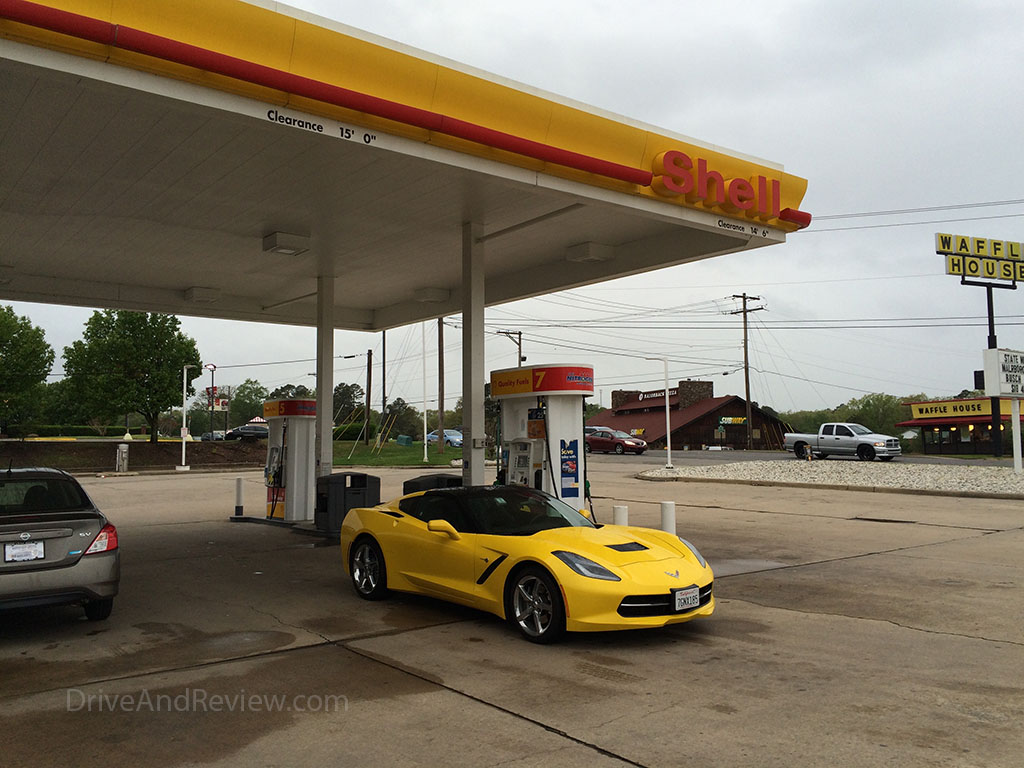 yellow c7 corvette at shell gas station
