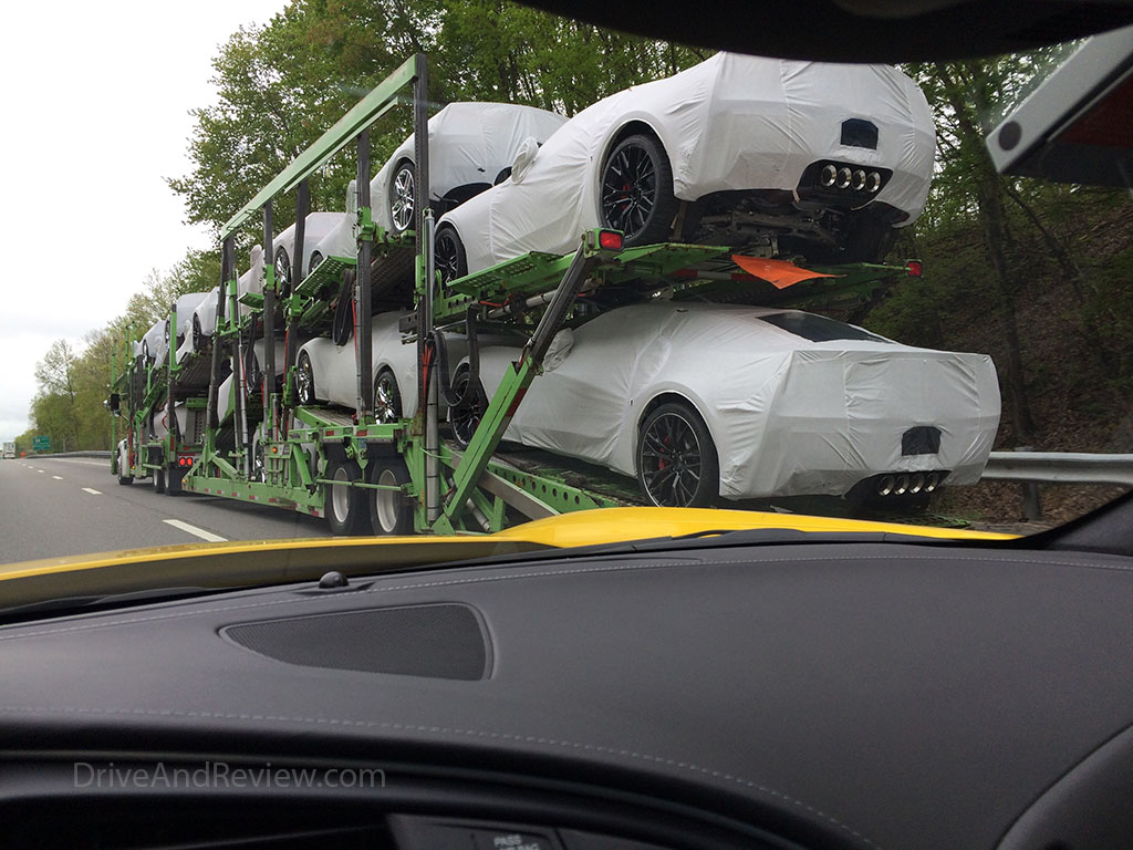 brand new corvette on delivery truck
