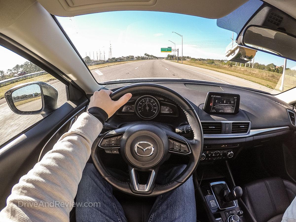 2017 white Mazda 3 drive