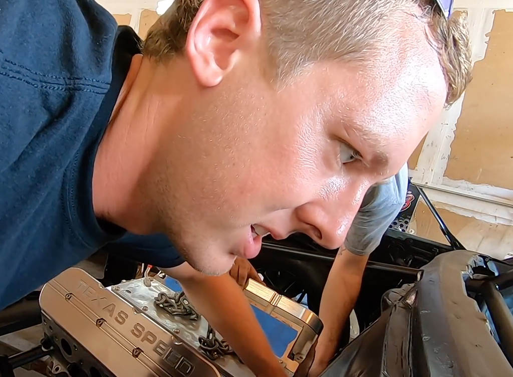 Cleetus McFarland working on cars