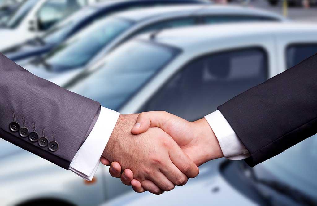 car deal handshake
