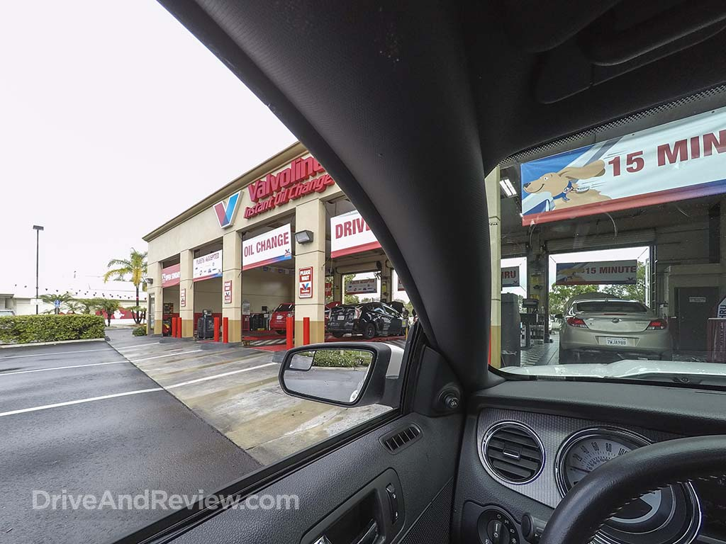 driving up to oil change garage
