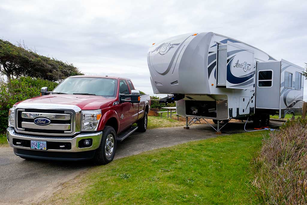 red Ford F-150 with trailer